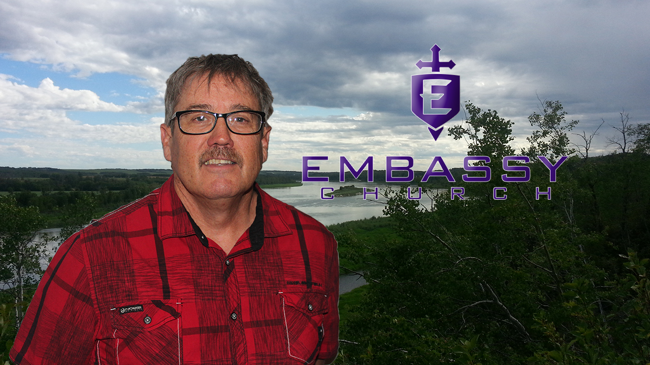 A Picture of Stephen MacDonald next to the Embassy Church Logo